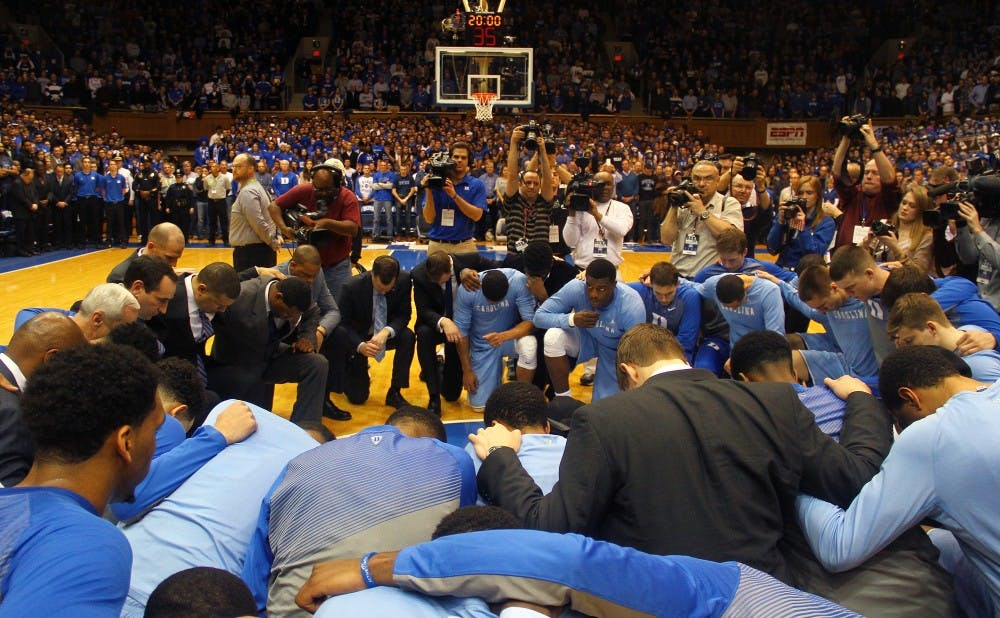 A memorable tribute occurred before the 239th installment of Duke-UNC with players and coaches on both sides coming together at mid-court.