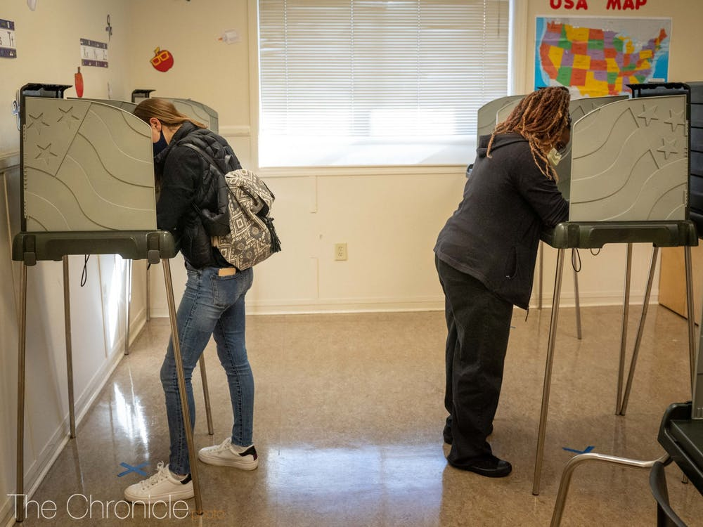 <p>Voters fill out their ballots at the 5th precinct voting site in Durham.&nbsp;</p>
