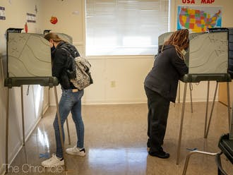 Voters fill out their ballots at the 5th precinct voting site in Durham.