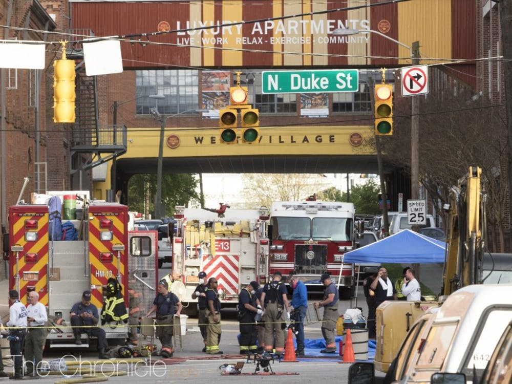 The explosion site, which occurred in downtown Durham near West Village, was filled with responders working.
