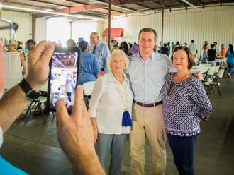 Dan McCready, Trinity '05, takes a photo with supporters after a rally in Lumberton.