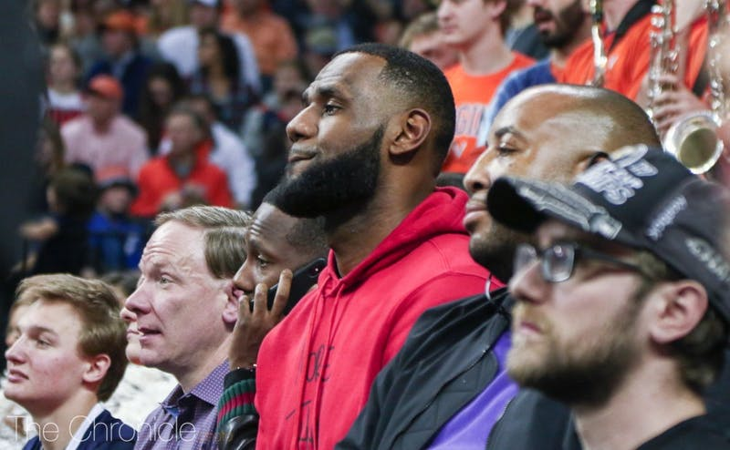LeBron James sat courtside at John Paul Jones Arena Saturday night along with Lakers teammate Rajon Rondo.