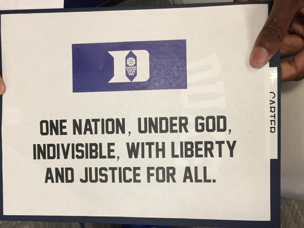 The Blue Devils had this sign in their locker room to represent what they stand for during the national anthem.
