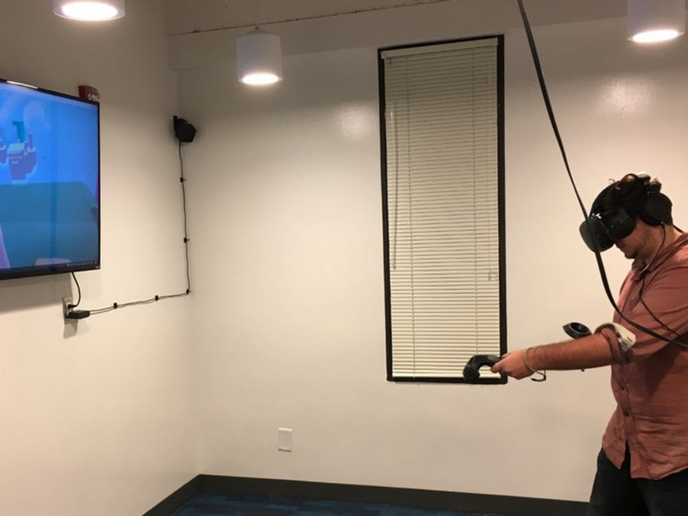 The virtual reality room includes 50 games that are programmed on the system, which took about eight months to build.