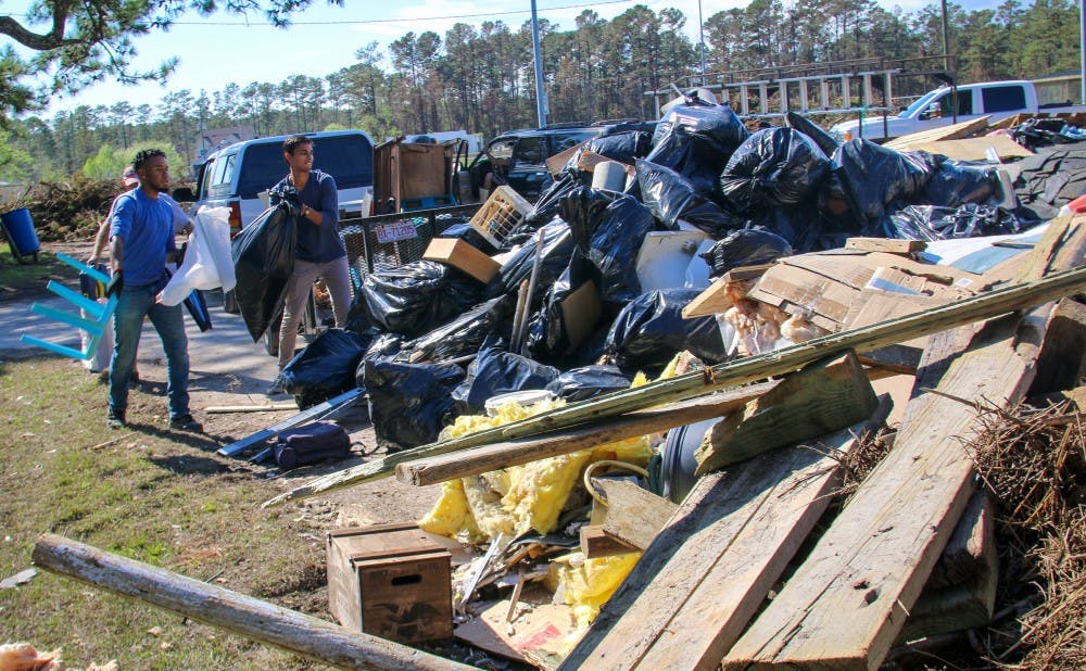 Duke undergraduates and graduate students came together to bring supplies and help clean houses damaged from Hurricane Florence in Carteret County, where the Marine Lab is located.