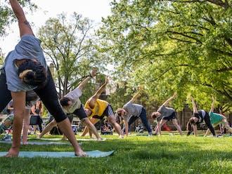 Graduate students at a yoga class.