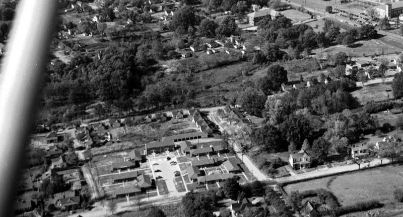 Erwin Mills is at the top right of this 1950s era aerial photograph of the area that became Central Campus. The land at the bottom right is now the 300 Swift Apartments and the land at the back of the shot is now Central Campus. Photo via Open Durham and Durham Herald-Sun.