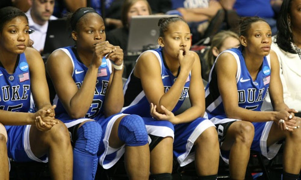 The collegiate careers of Jasmine Thomas, Karima Christmas and Krystal Thomas came to a close Tuesday night at the hands of the Huskies, who beat the Blue Devils by 30-plus points for the second time this season. Jasmine Thomas had 17 points, but Duke couldn't stop Maya Moore, who led Connecticut with 28 points.