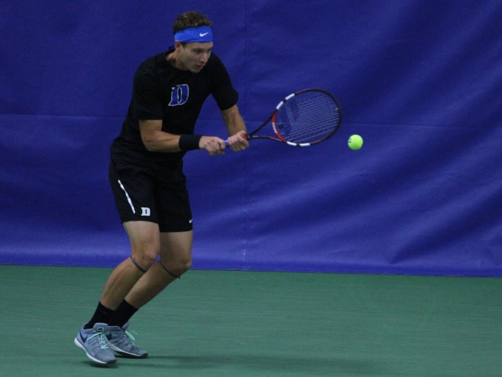 Senior Jason Tahir was one of three Blue Devil singles players to secure the win against Illinois Friday.
