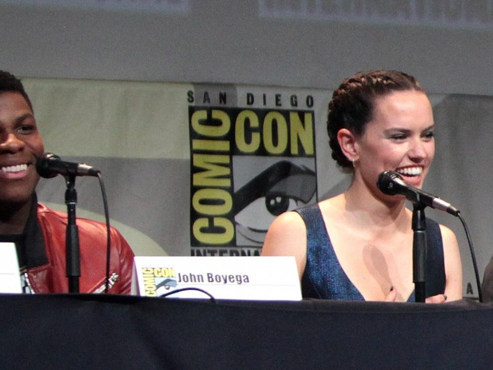 "John Boyega and Daisy Ridley, who star in both ""Star Wars"" sequels, speak at San Diego Comic Con in 2015."