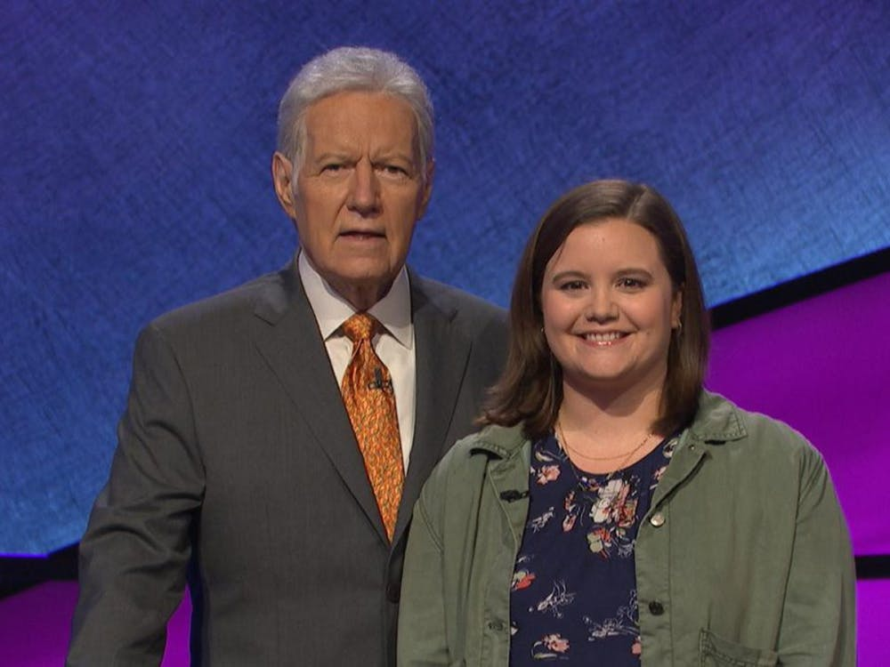 <p>Duke employee Abby Grubbs with Jeopardy! host Alex Trebek. Courtesy of Jeopardy Productions, Inc.</p>