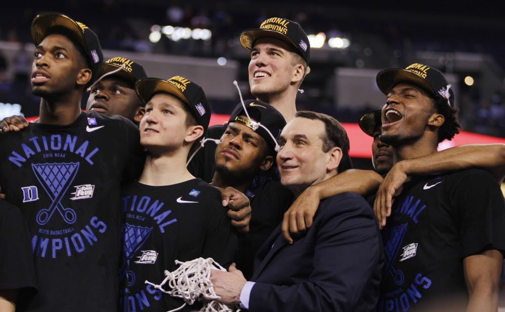 Duke celebrates its fifth national title after a dramatic 68-63 against Wisconsin Monday night.