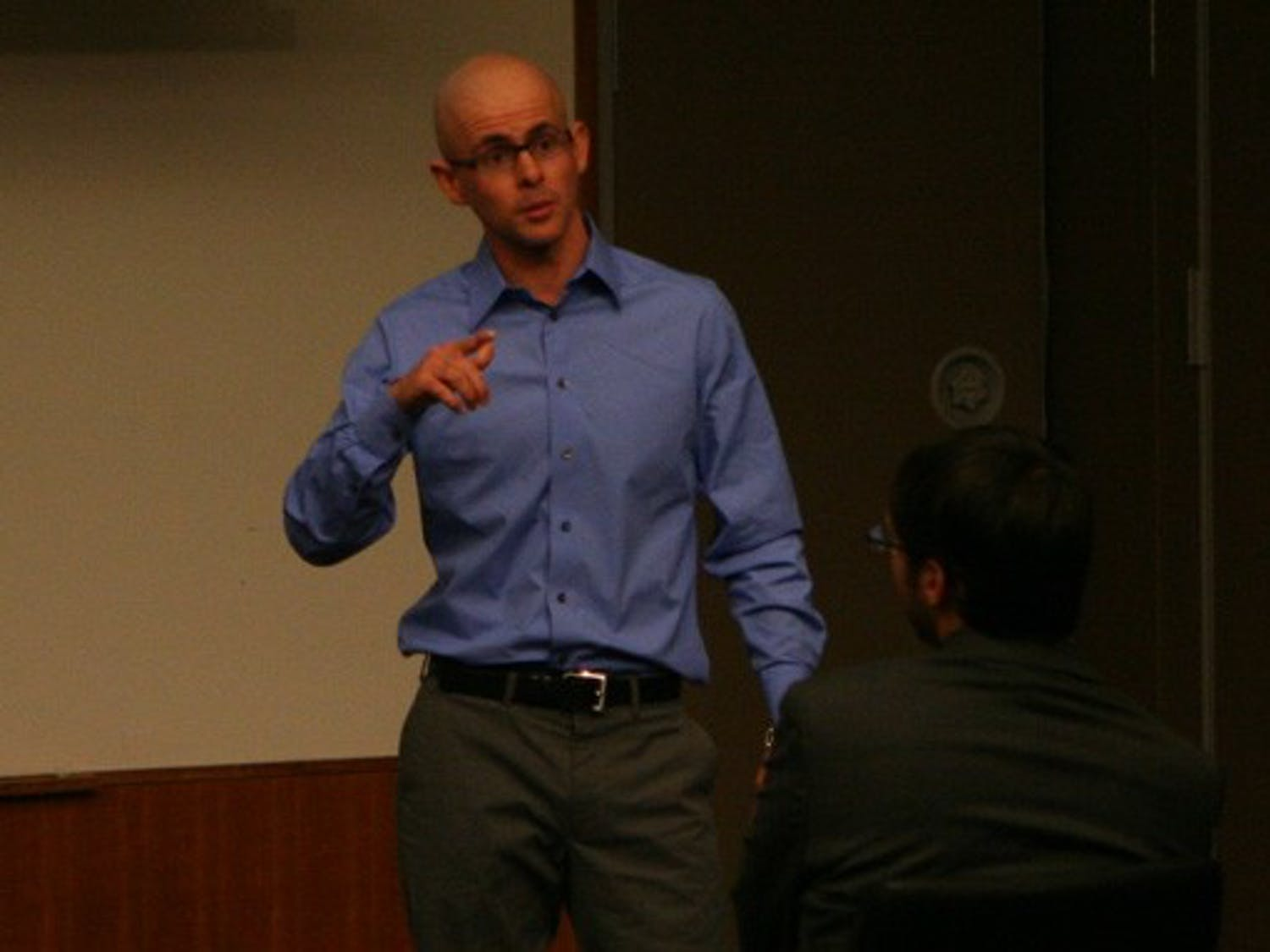 """DSG Treasurer Sam Halls presents the SOFC Reform Commission's findings at the DSG meeting Wednesday night. Halls proposed the creation of """"bucket funds"""" to cover on-campus performance groups' spending next year."""