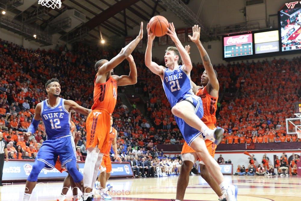 <p>Matthew Hurt drives to the basket against Virginia Tech.</p>