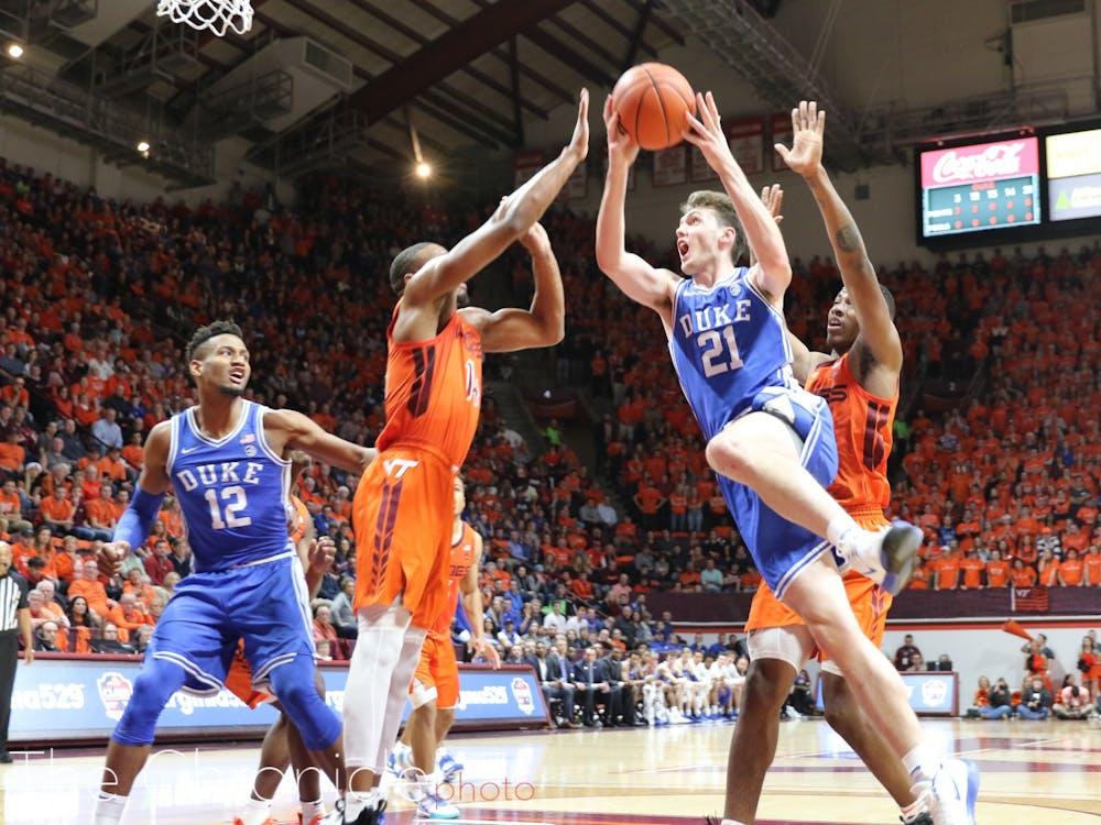 Matthew Hurt drives to the basket against Virginia Tech.