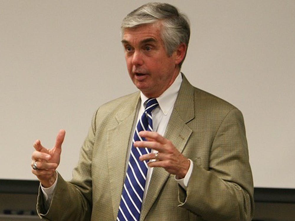 Director of Athletics Kevin White discusses the department's budget challenges at the Academic Council meeting Thursday.