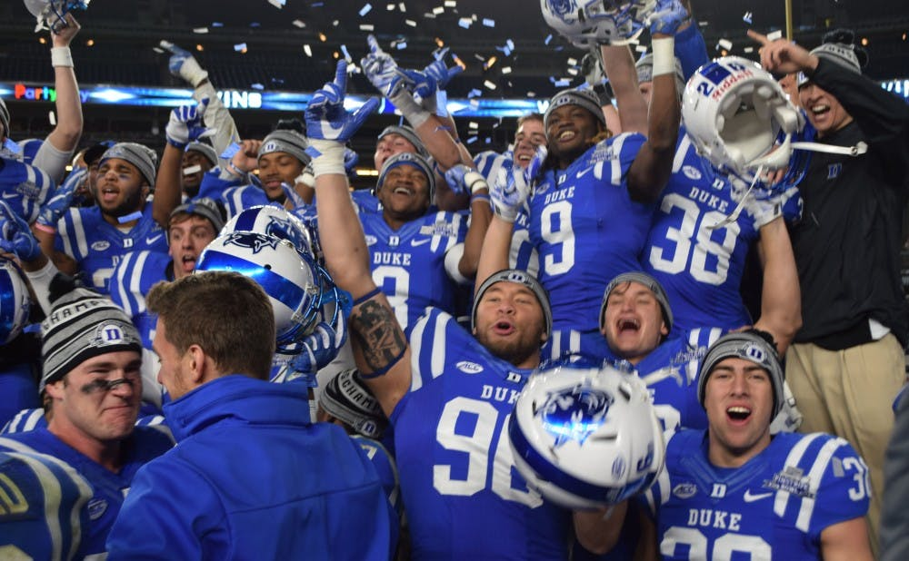 <p>Duke celebrates after its overtime win in the New Era Pinstripe Bowl&nbsp;at Yankee Stadium&mdash;the program's first postseason victory since the 1961 Cotton Bowl.</p>