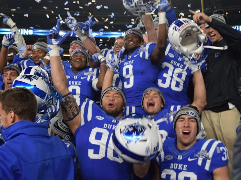 Duke celebrates after its overtime win in the New Era Pinstripe Bowlat Yankee Stadium—the program's first postseason victory since the 1961 Cotton Bowl.