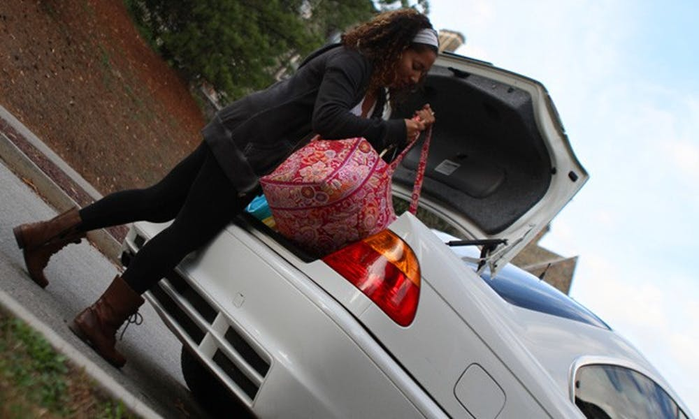Stephanie Jones, sophomore, unpacks her car after Thanksgiving break.
