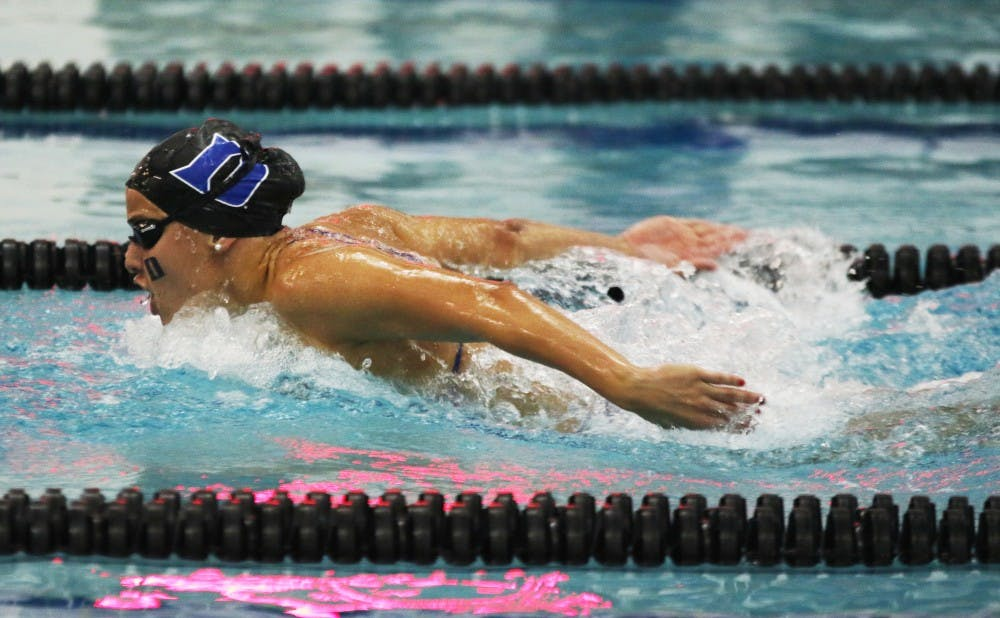 <p>The Blue Devils rewrote the record books Saturday at Taishoff Aquatic Pavilion, beating Pittsburgh in the process.</p>