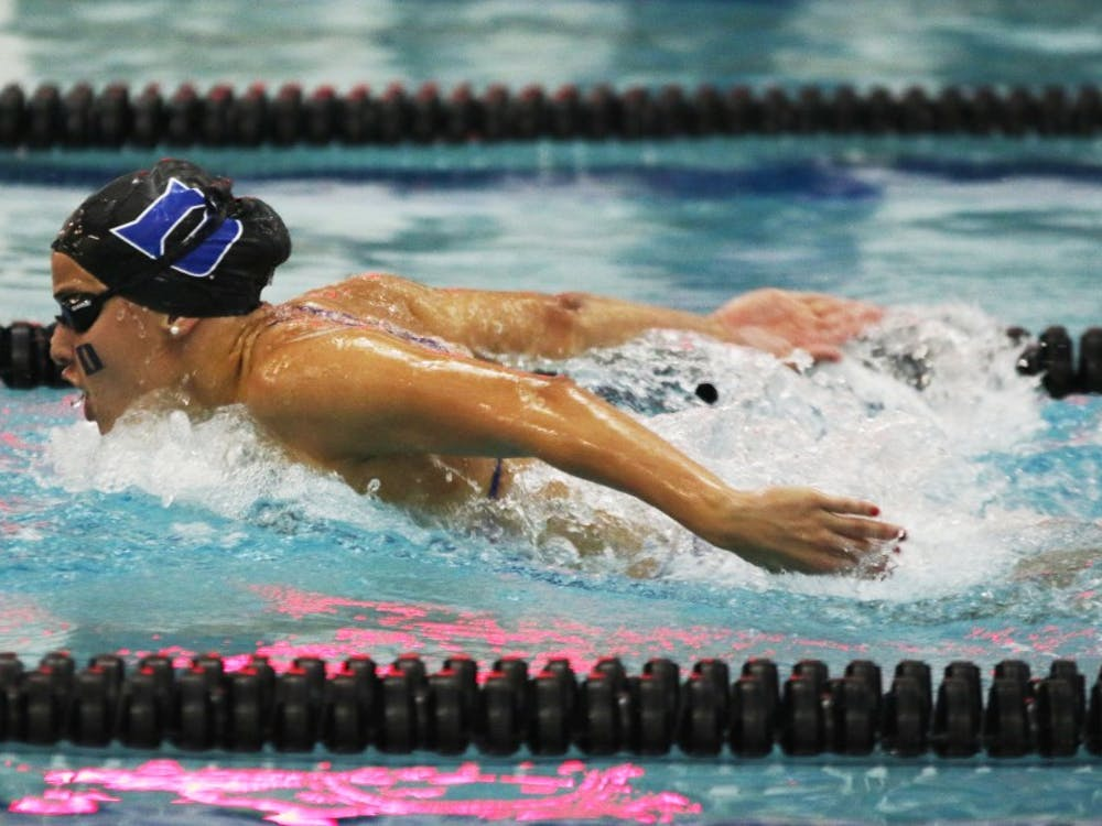 The Blue Devils rewrote the record books Saturday at Taishoff Aquatic Pavilion, beating Pittsburgh in the process.