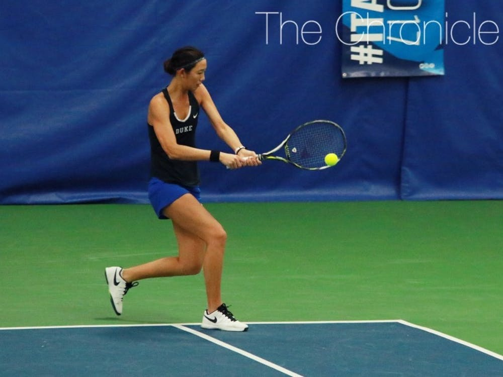 Duke freshman Meible Chi and the Blue Devils made quick work of two Florida opponents to start their busy week.