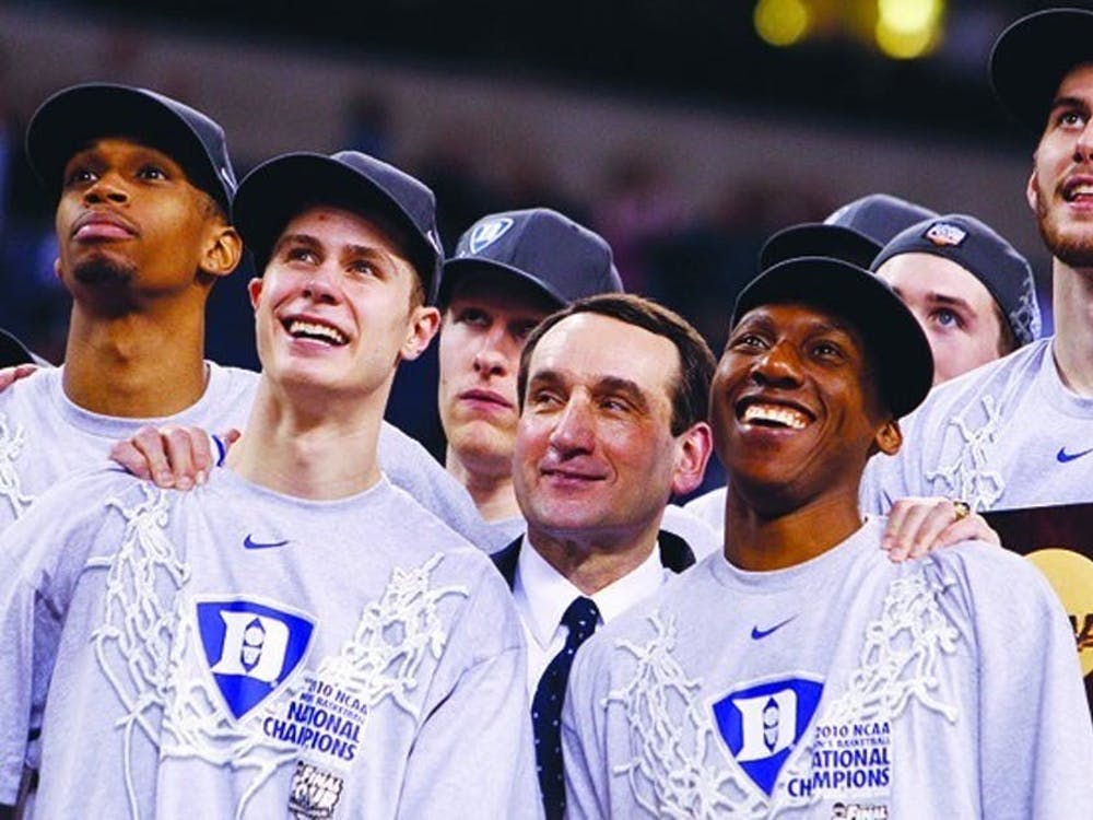 Lance Thomas (far left) and teammates right after the Blue Devils' 2010 national championship victory.