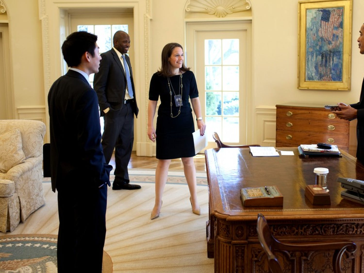 President Barack Obama jokes with Special Assistant Eugene Kang,  Personal Secretary Katie, Johnson and Personal Aide  Reggie Love in the Oval Office 3/5/09. 