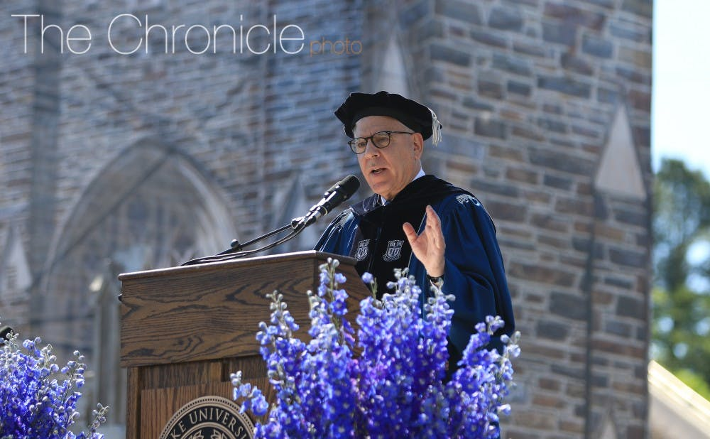 <p>David Rubenstein, former chair of the Board of Trustees, speaking at Commencement in 2017.</p>