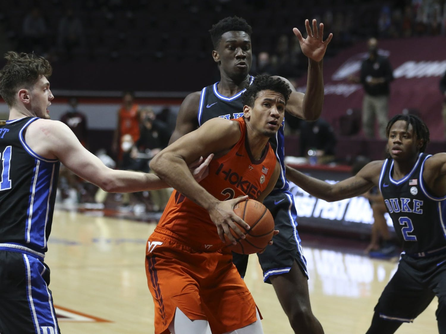 Virginia Tech's Keve Aluma (22) is surrounded by Duke defenders, from left, Matthew Hurt (21)  Mark Williams (15) and DJ Steward (2) in the first half of an NCAA college basketball game in Blacksburg, Va., Tuesday January12 2021. (Matt Gentry/The Roanoke Times via AP, Pool)