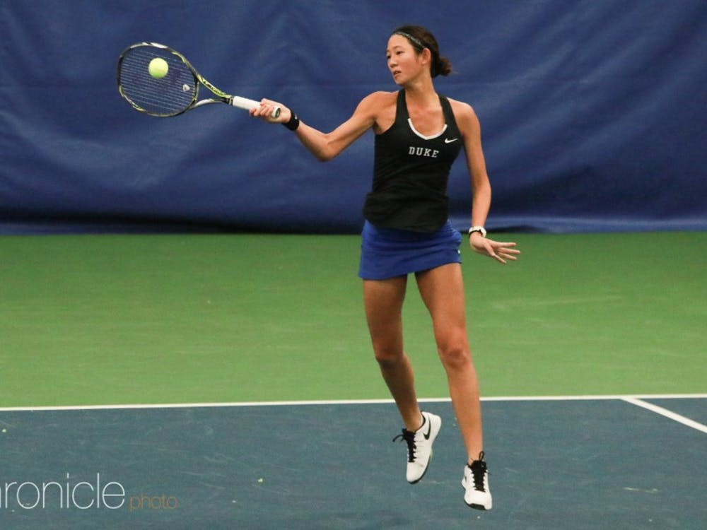 Freshman Meible Chi overcame multiple deficits in her singles match as the Blue Devils outlasted No. 25 Northwestern Sunday afternoon.