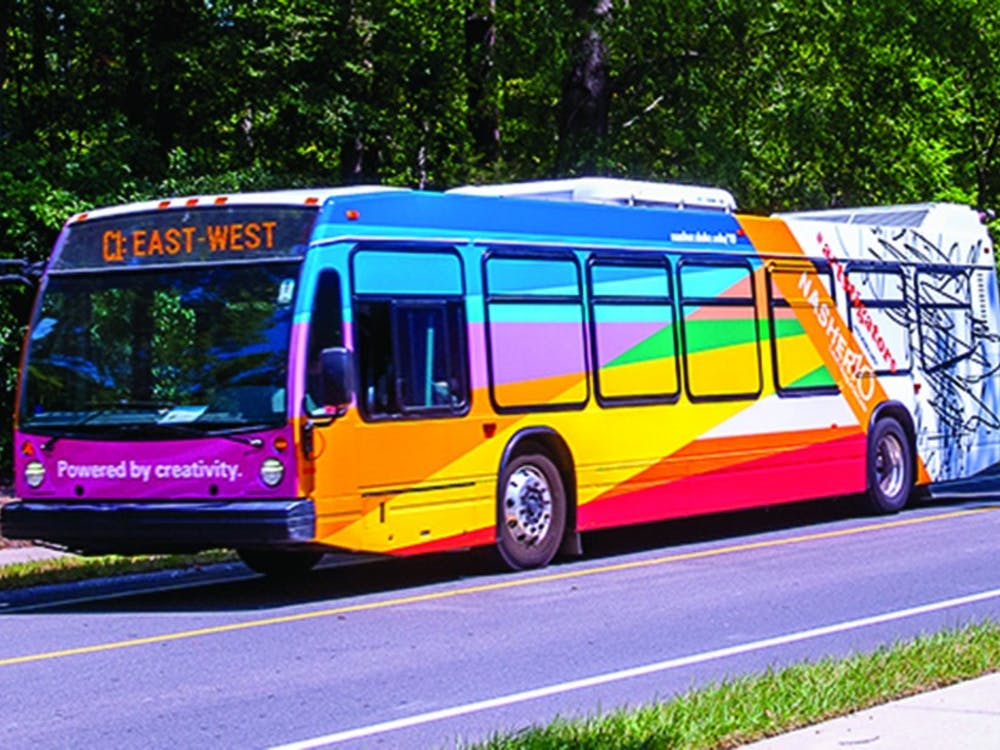 A new art bus features the Artstigators logo.