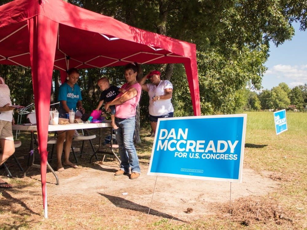 Alicia Jacobs, far right, and her family campaigned for McCready outside an early voting site in Pembroke.