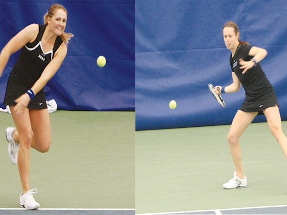 The doubles point came down to Annie Mulholland, left, and Marianne Jodoin, right, who secured the win for the Blue Devils.