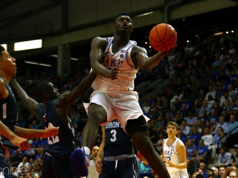 Zion Williamson wowed fans with several dunks and led the White team to victory at Countdown to Craziness Friday.