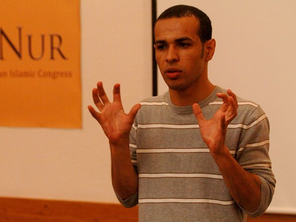 Ahmad Ghashmari, a Jordanian Ph.D. student at Kent State University, speaks about the global practice of honor killings in the Breedlove Room of Perkins Library Wednesday night.