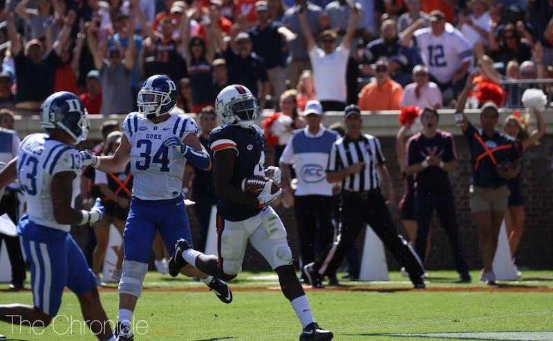 Olamide Zacceaus caught Virginia's first touchdown pass to tie the score, and quarterback Kurt Benkert kept the Cavalier offense rolling.