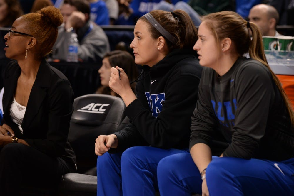 <p>Redshirt sophomore Rebecca Greenwell (middle) was unavailable again Friday due to a back injury.</p>