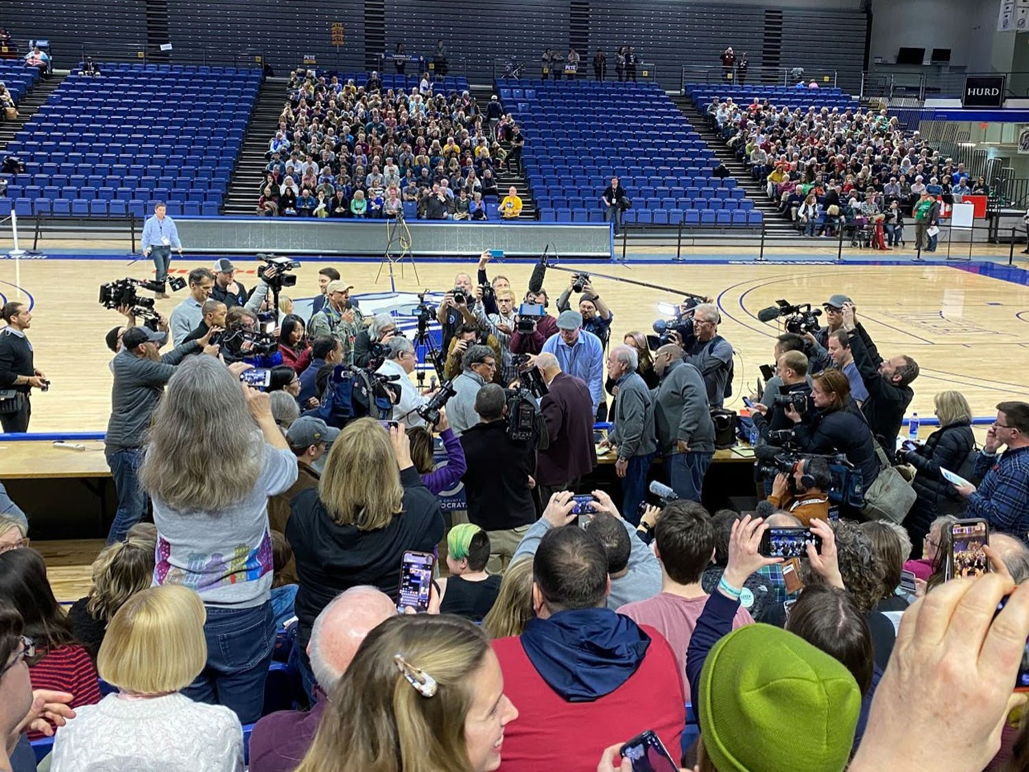 The media swarms Jeffrey Goetz, caucus chair of Des Moines precinct 62. This caucus, one of the state's largest, was held in the Drake University Knapp Center––a stadium that seats more than 7,150.