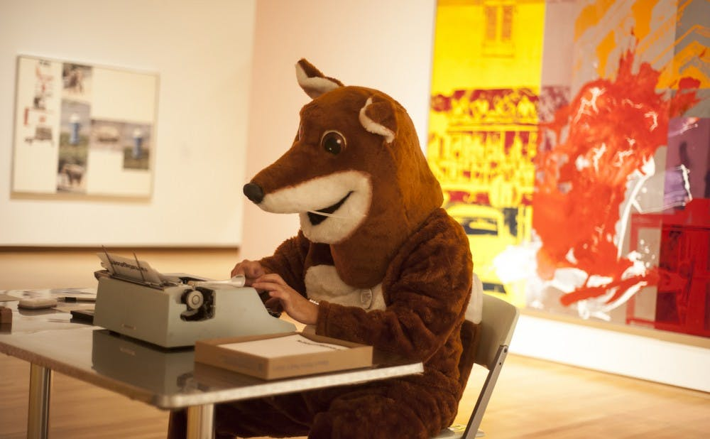 <p>Chris Vitiello, more commonly known to students as Poetry Fox, sits behind his trademark typewriter at the Nasher Museum of Art.</p>
