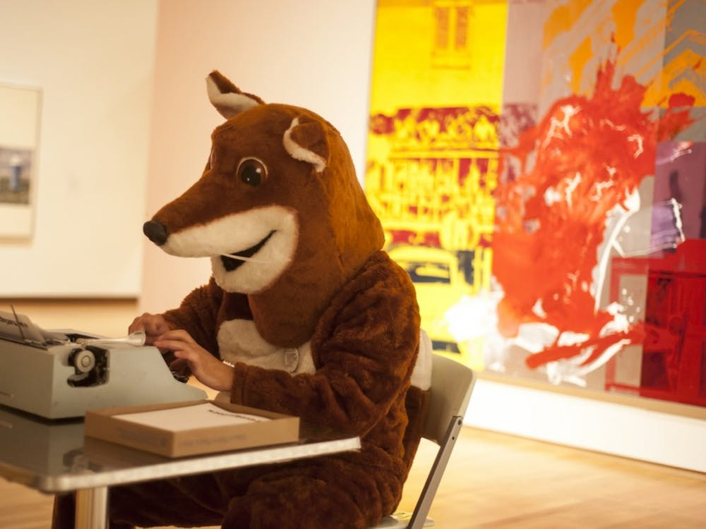 Chris Vitiello, more commonly known to students as Poetry Fox, sits behind his trademark typewriter at the Nasher Museum of Art.
