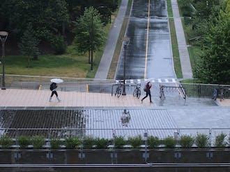 Umbrellas bobbed along the Bryan Center plaza.