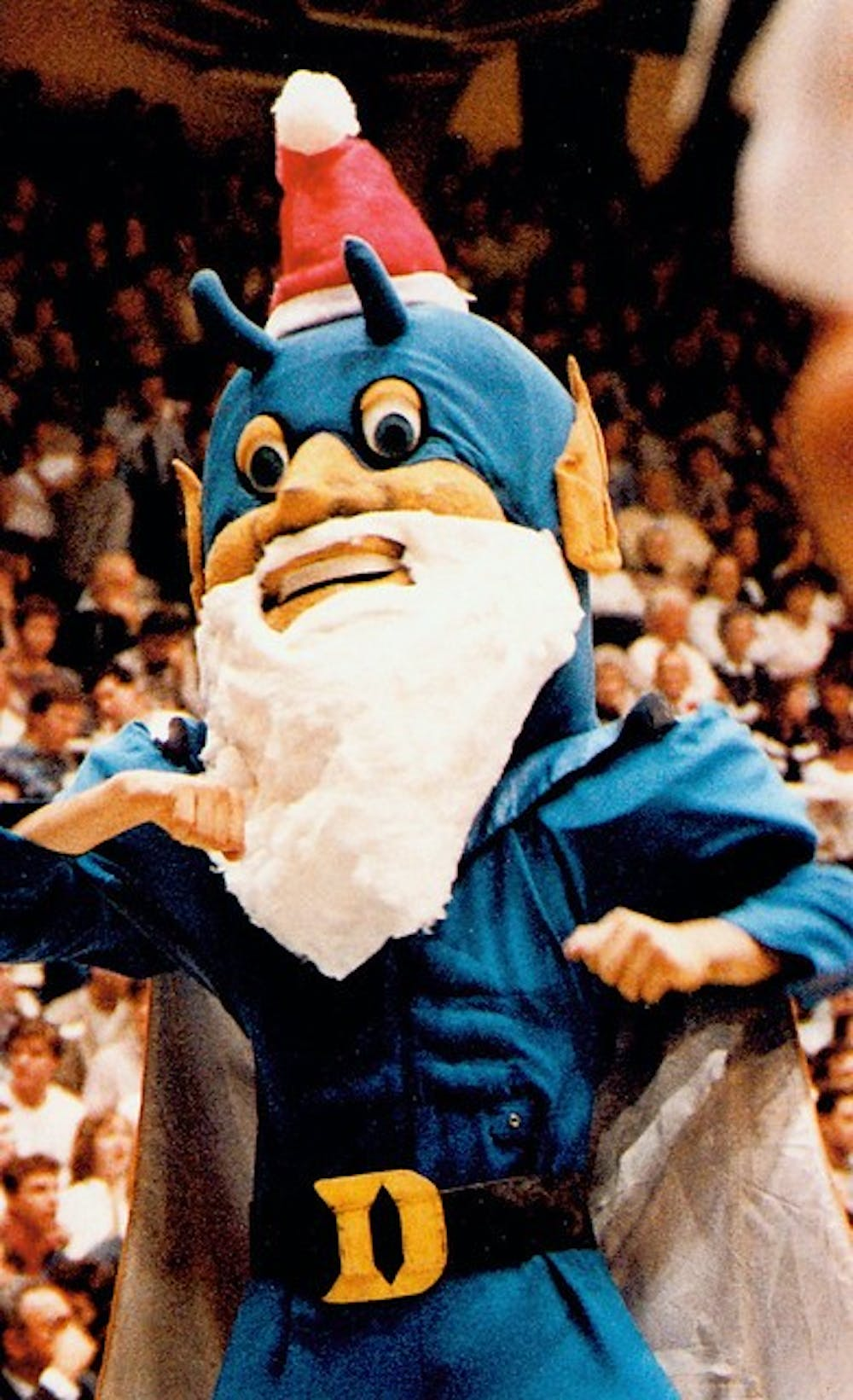 The Blue Devil masquerades as Santa Claus in 1986