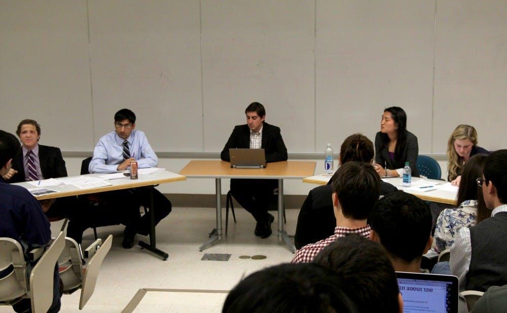 Editorial pages editor Scott Briggs moderated a debate between (pictured left to right) seniors Daniel Strunk and Ajeet Hansra versus junior Joyce Lau and senior Stefani Jones.