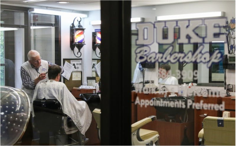 The Duke Barbershop in May, as longtime manager David Fowler cuts a customer's hair.