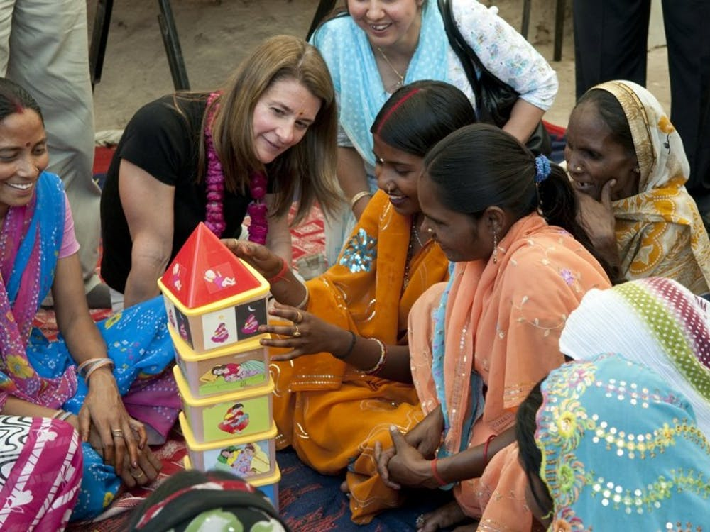 Melinda French Gates and participants at a Sure Start Project initiative to promote maternal and newborn health in Kathghara Village, Fatehpur District, U.P., India on March 23, 2010. The women are playing a stacking game to promote family wellness.