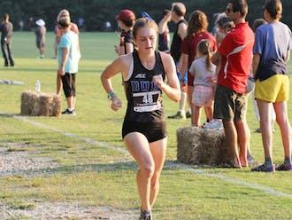 Michaela Reinhart finished in the top 30 in the region as a freshman next to classmate Amanda Beach.