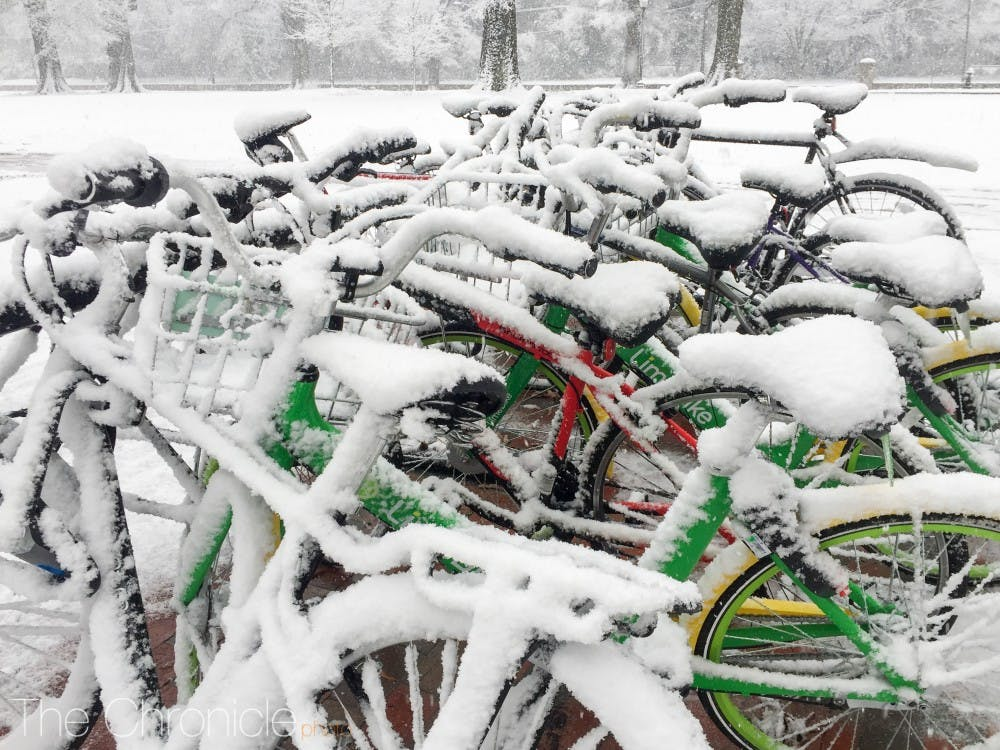 The new Lime bikes on Duke's East Campus covered in snow.