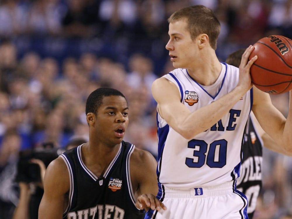 Photos from Duke's National Championship Victory over Butler. Duke survived a late run by Butler to win their fourth National Championship 61-59.