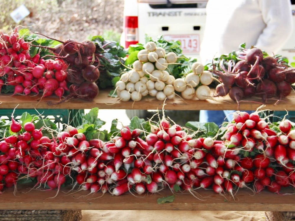 Red Hawk Farms' vibrant display of turnips, beets and other tubular root vegetables at last Saturday's Durham Farmers' Market.